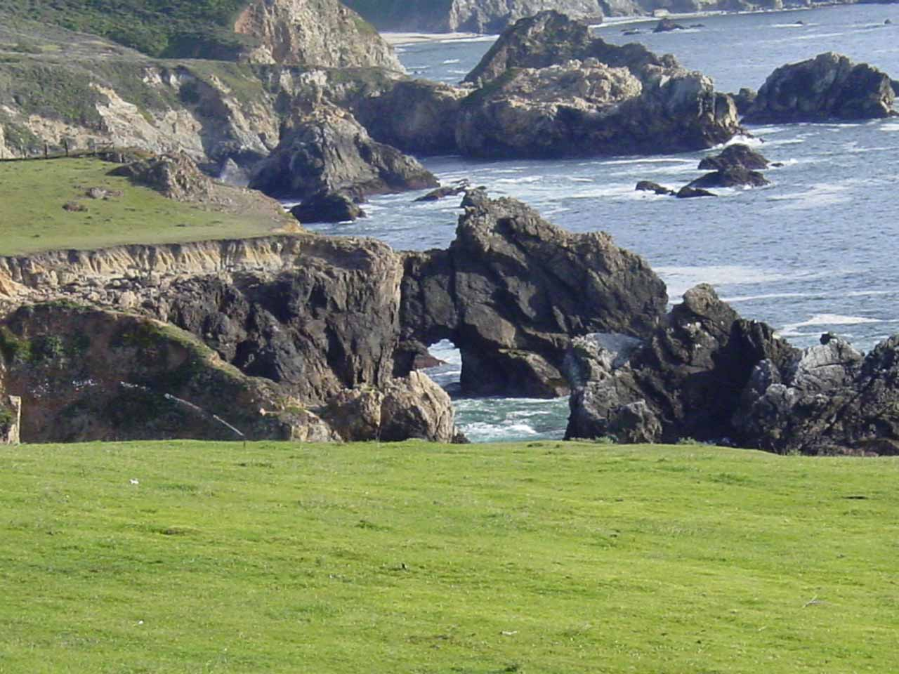 Not far from Julia Pfeiffer Burns State Park is a stretch of lovely coastline including this distant but pretty sea arch