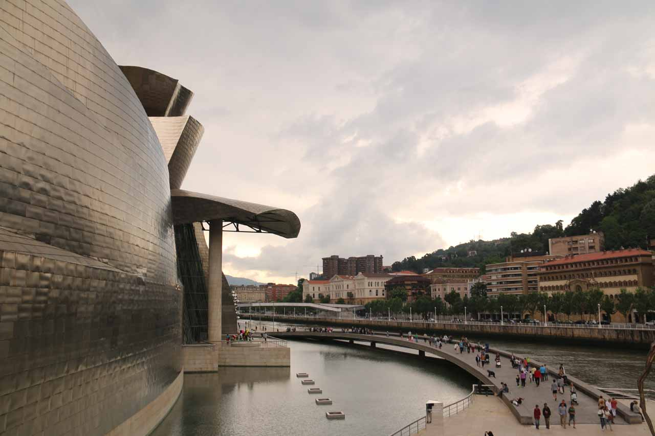 Looking down at the walkway crossing between the front of the Guggenheim museum and the Ria de Bilbao