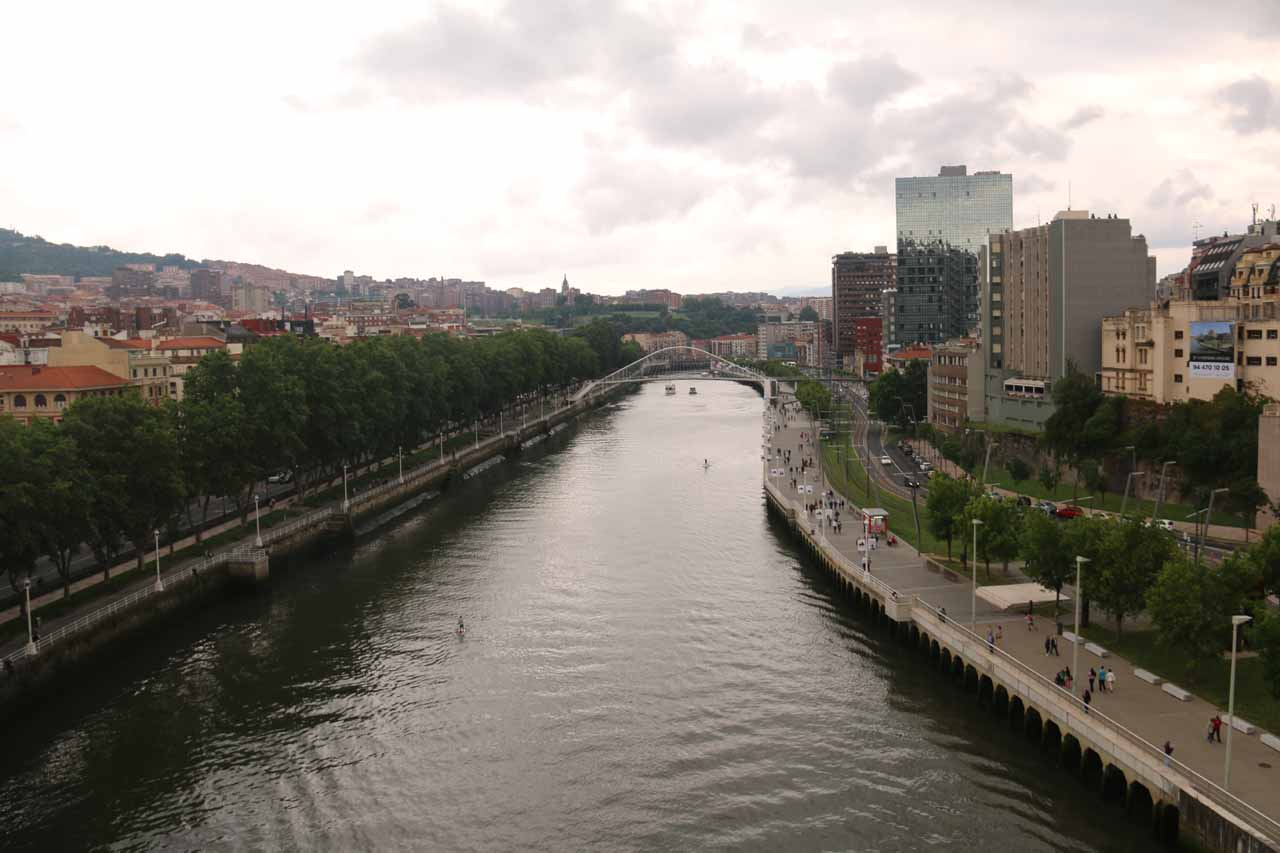 Looking east away from the Guggenheim Bilbao museum along the Ria de Bilbao from the busy road bridge