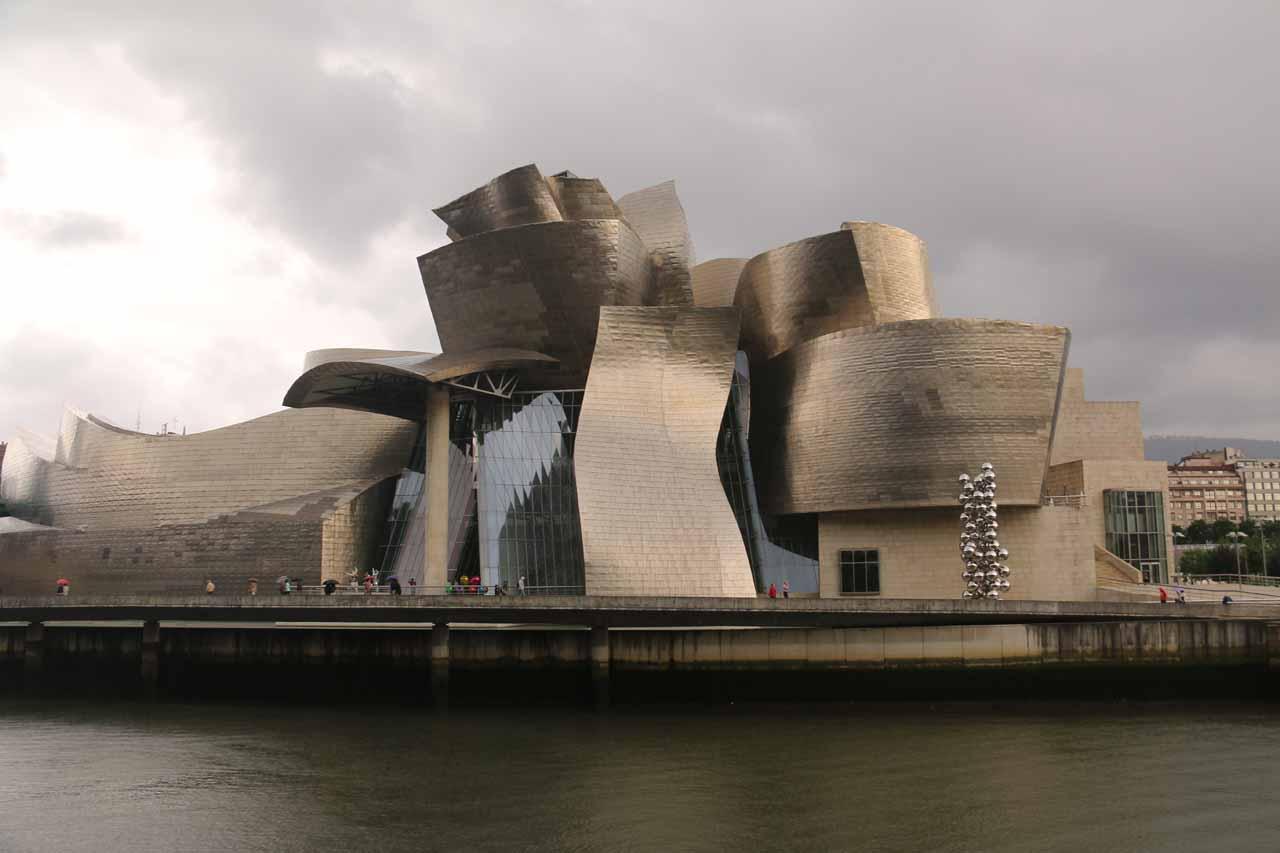Looking directly across the Ria de Bilbao towards the Guggenheim Bilbao museum just before the rain fell hard