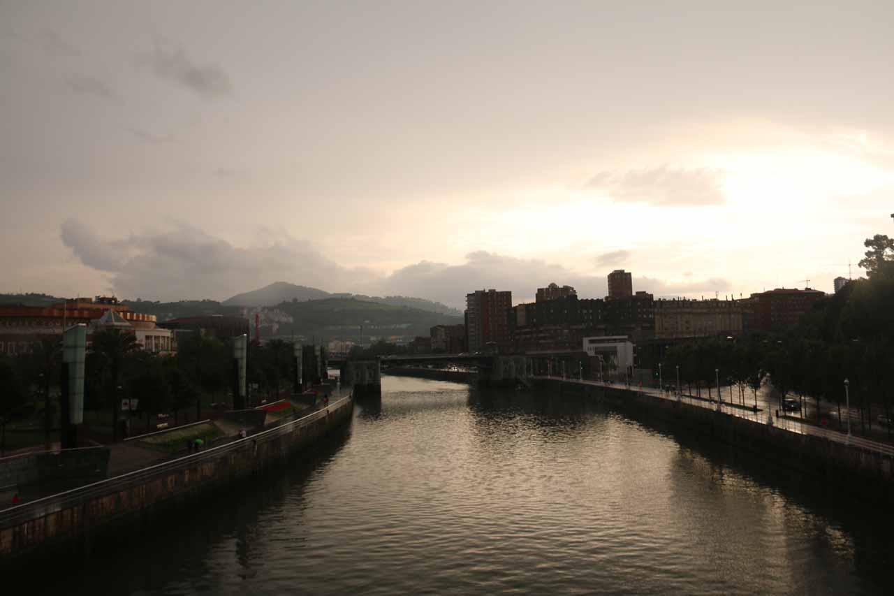 Looking west towards the setting sun trying to break through the thick and threatening rain clouds near the Guggenheim Bilbao