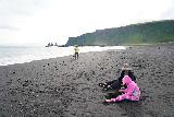 Black_Sand_Beach_082_08072021 - Julie continuing to watch Tahia work on her black sand volcano while Mom was checking out the Black Sand Beach