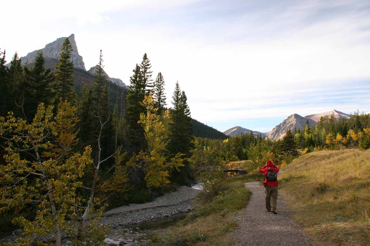 Julie on the Blackiston Falls trail while surrounded by beautiful mountains and dense forests