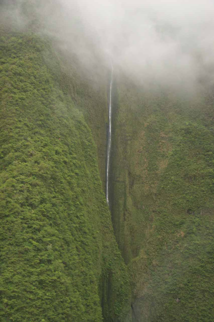 I believe this is Mana-nole Falls under the clouds as we flew in and out of Waihe'e Valley in 2007