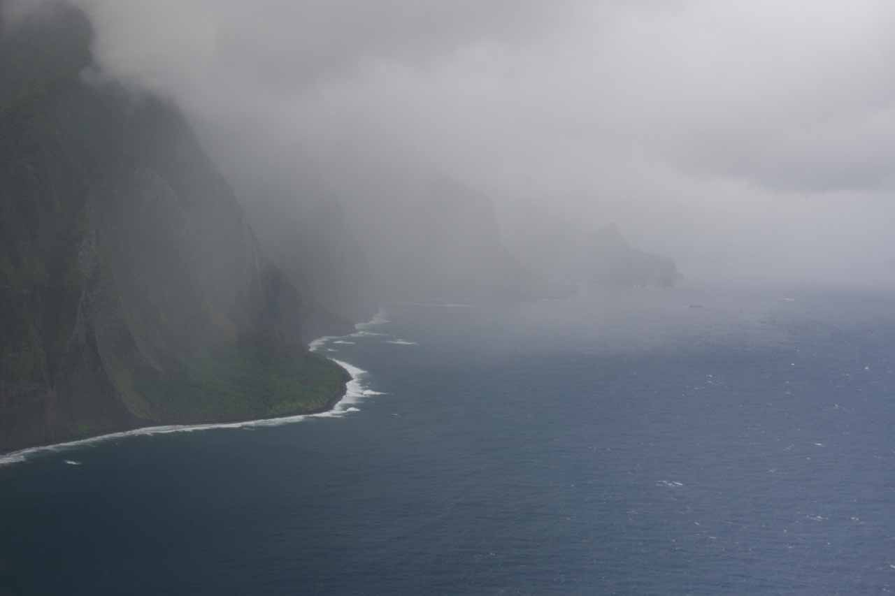 Entering a mean-looking squall on Moloka'i's North Shore