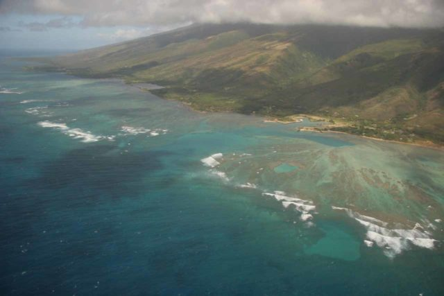 Blue_Hawaiian_Maui_Heli_198_02252007 - Aerial view of the reefs and fish ponds facing the drier southern shores of Moloka'i