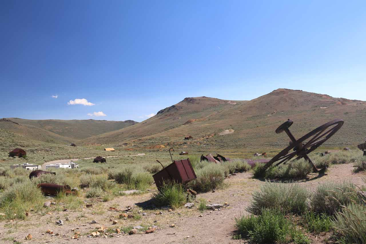 Looking towards the sparser east section of Bodie past an old wheel and cart