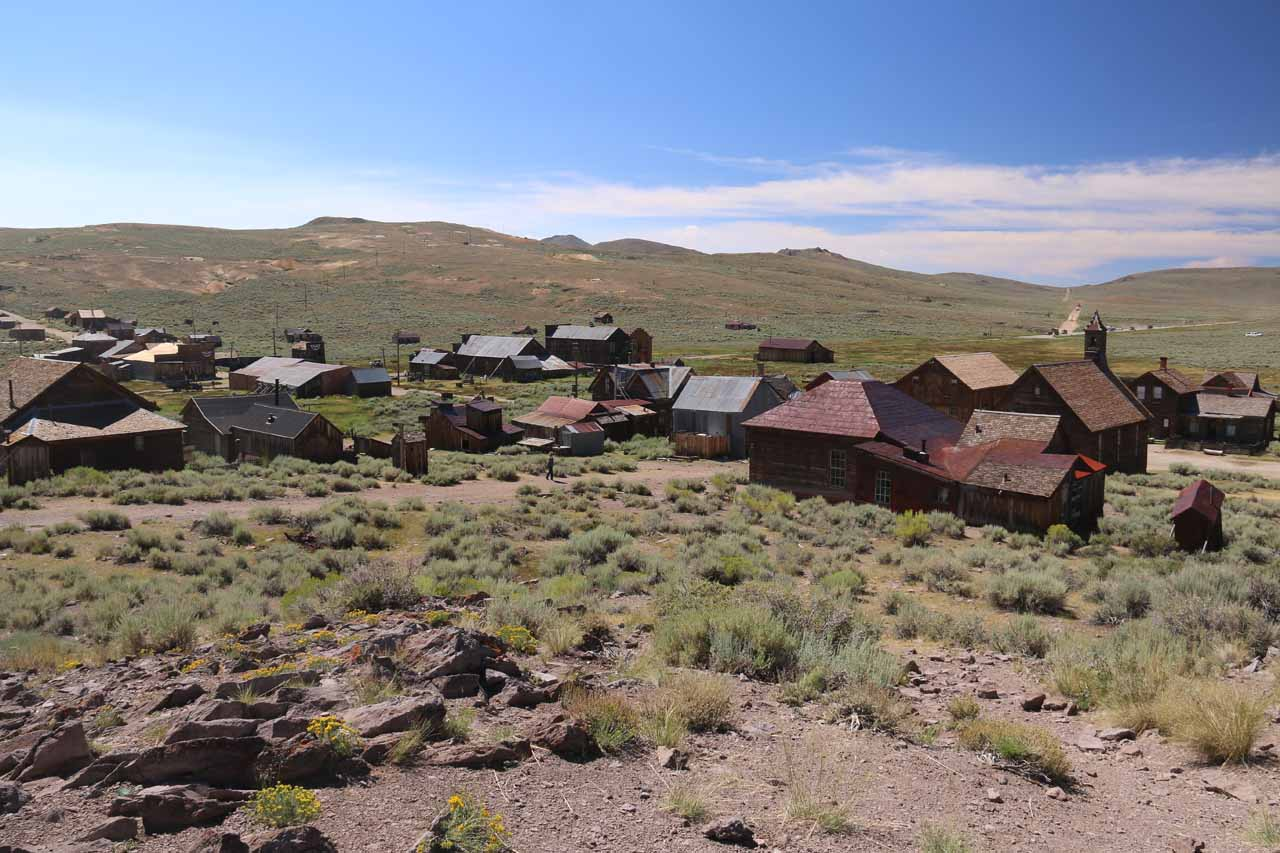 Looking down towards the vast majority of buildings belonging to the ghost town of Bodie seen from atop a small hill