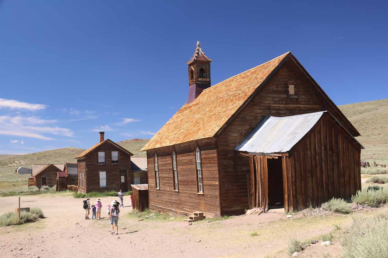 The gang walking towards the front of the church in Bodie
