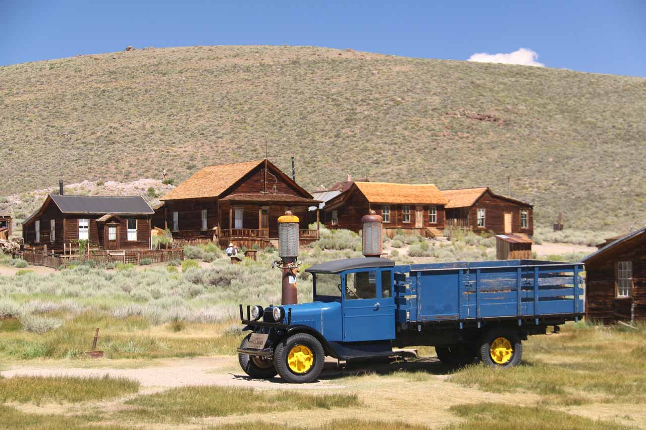 Looking towards an old truck with some old Shell Station pumps at Bodie