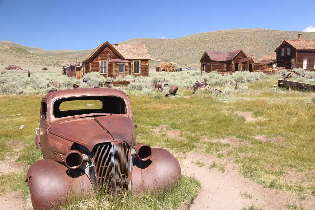Contextual view of an old car fronting some buildings of Bodie