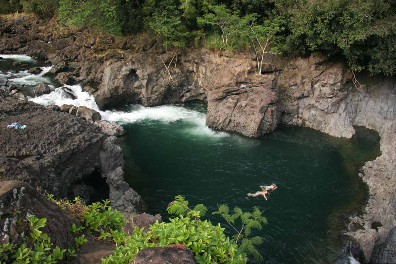 A pair of people swimming in one of the pools within the Boiling Pots when the conditions were calm