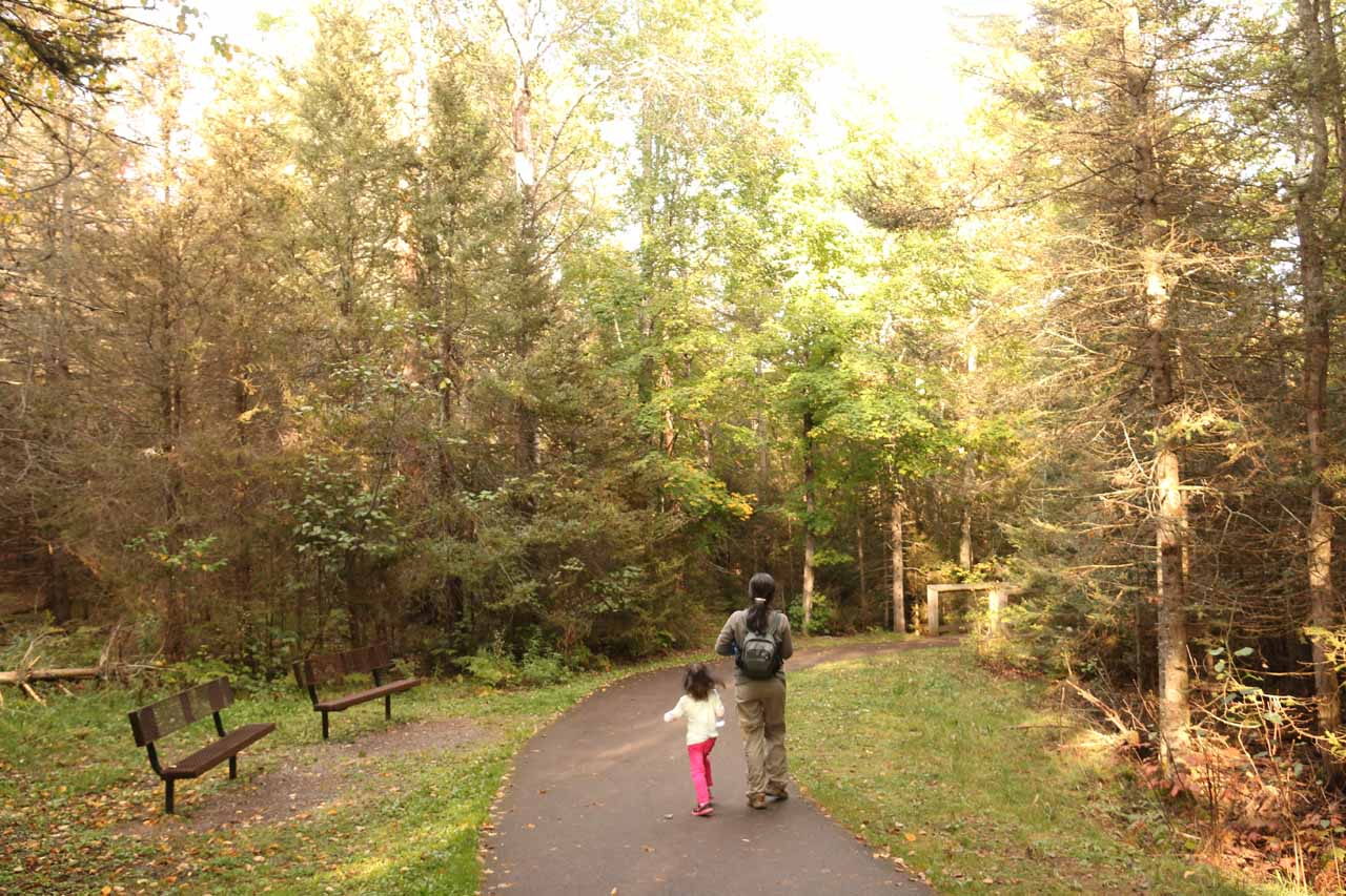 Julie and Tahia on the short paved trail descending towards the boardwalk before Bond Falls