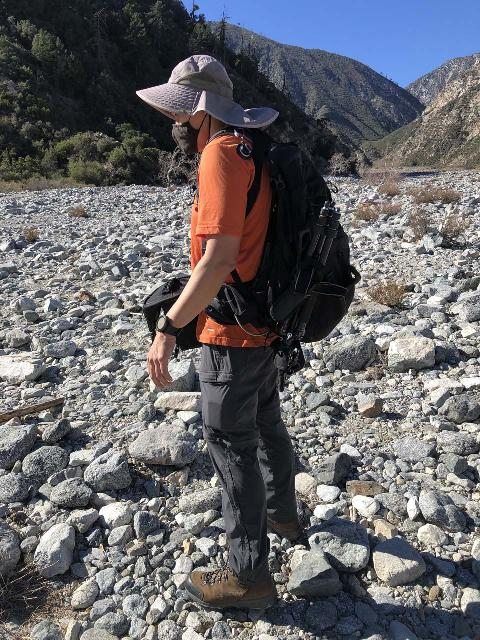 Me using the Osprey Manta 34 while on a hike involving lots of boulder walking en route to a waterfall