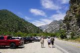 Bonita_Falls_010_06122020 - Julie walking past a lot of cars as we looked for a suitable spot to cross Lytle Creek, but other people passed her well within 6 feet
