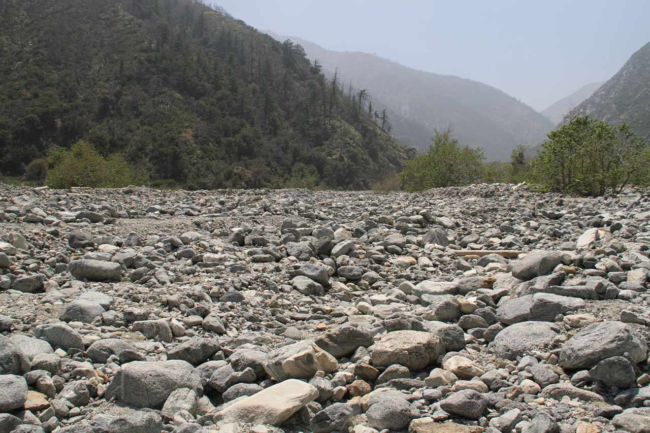 Looking downstream across the bouldery wash towards the campground and Lytle Creek from the south wall