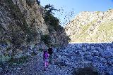 Bonita_Falls_028_01182021 - Tahia following along the shaded graffiti-laced wall en route to Bonita Falls