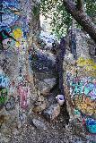 Bonita_Falls_054_01182021 - Looking down at someone who set up a trash can by a bunch of graffiti-defiled rocks near Bonita Falls