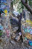 Bonita_Falls_054_01182021 - While scrambling back up to the caves and an elevated view of Bonita Falls, someone left a trash bin here among the heavily-tagged rocks