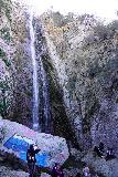 Bonita_Falls_078_01182021 - Angled look up at the main drop of Bonita Falls with lots of people around its base