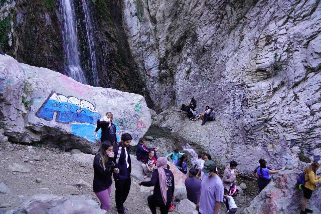 Bonita_Falls_080_01182021 - Lots of people gathered at the base of Bonita Falls without masks