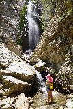 Bonita_Falls_082_06122020 - Tahia standing in front of the intermediate waterfall before the base of Bonita Falls, where there wee more people at its base