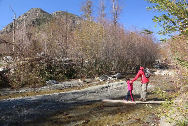 Bonita_Falls_15_011_12312015 - Julie and Tahia traversing Lytle Creek with the aid of some planks that someone had laid out here while the creek was in low flow