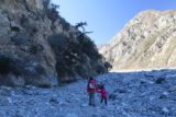 Bonita_Falls_15_031_12312015 - Julie and Tahia traversing the bouldery wash as we headed to the shady south wall, which also acted as our trail guide for much of the time we were in the wash itself en route to Bonita Falls in late December 2015