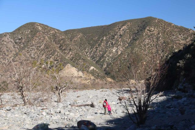 Bonita_Falls_15_148_12312015 - Julie and Tahia making their way back across the bouldery wash en route to our parked car at the base of those mountains up ahead