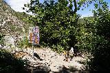 Bonita_Falls_185_06122020 - Julie and Tahia going past the tagged sign at the mouth of the canyon containing Bonita Falls