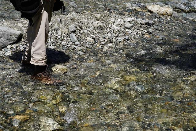 My waterproof hiking boots stepping in ankle-deep water and still keeping my feet dry