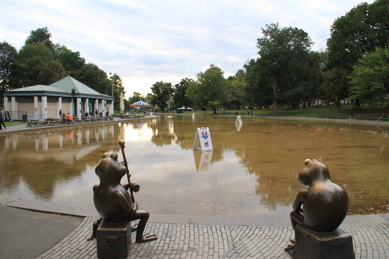 Some frog statues before a pond within Boston Commons