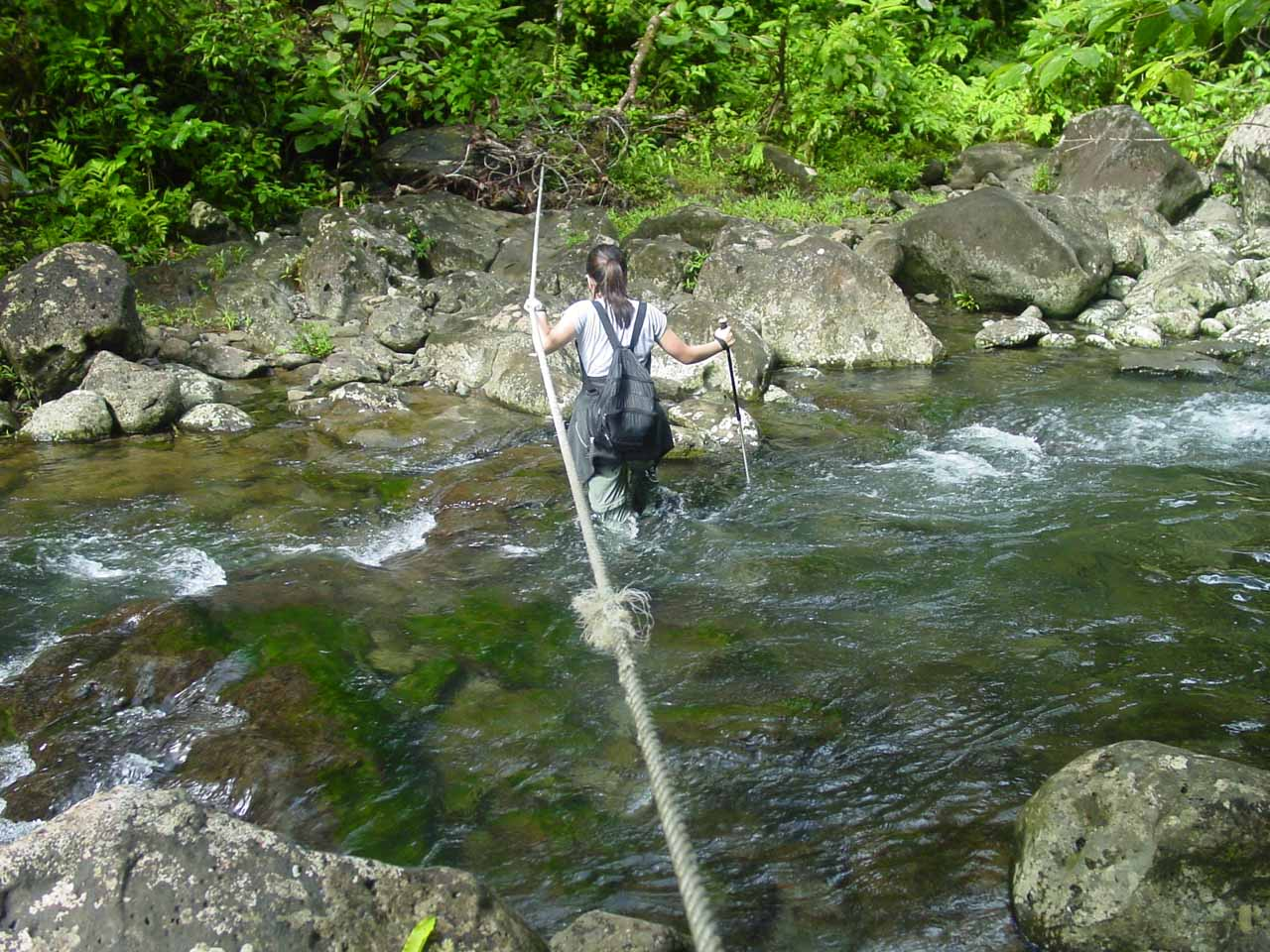 Julie crosses a particularly deep stream