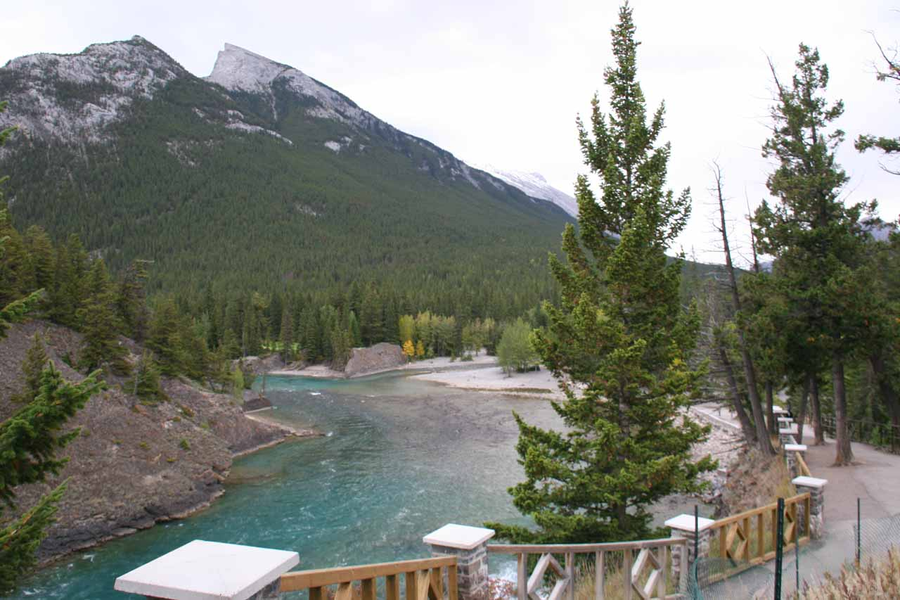 Looking down over the top of Bow Falls along the walkway towards Mt Rundle and another neighboring mountain