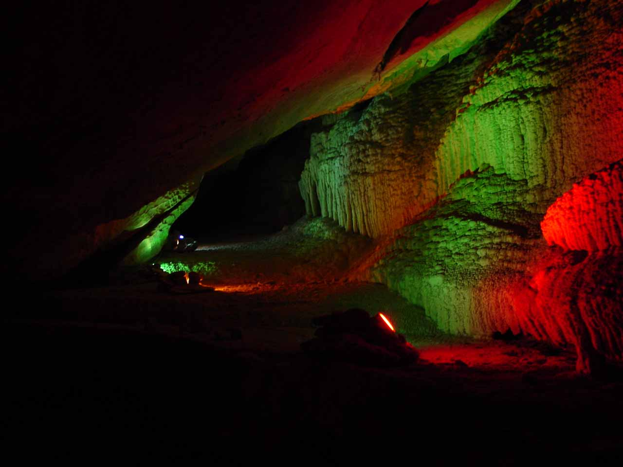 The colorfully lit interior of Boyden Cavern near Grizzly Falls