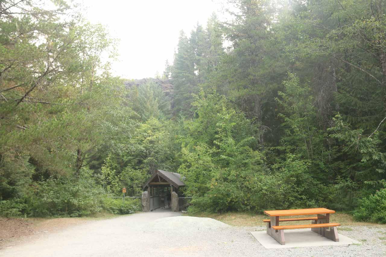 Walking past a picnic table towards the covered bridge traversing Brandywine Creek
