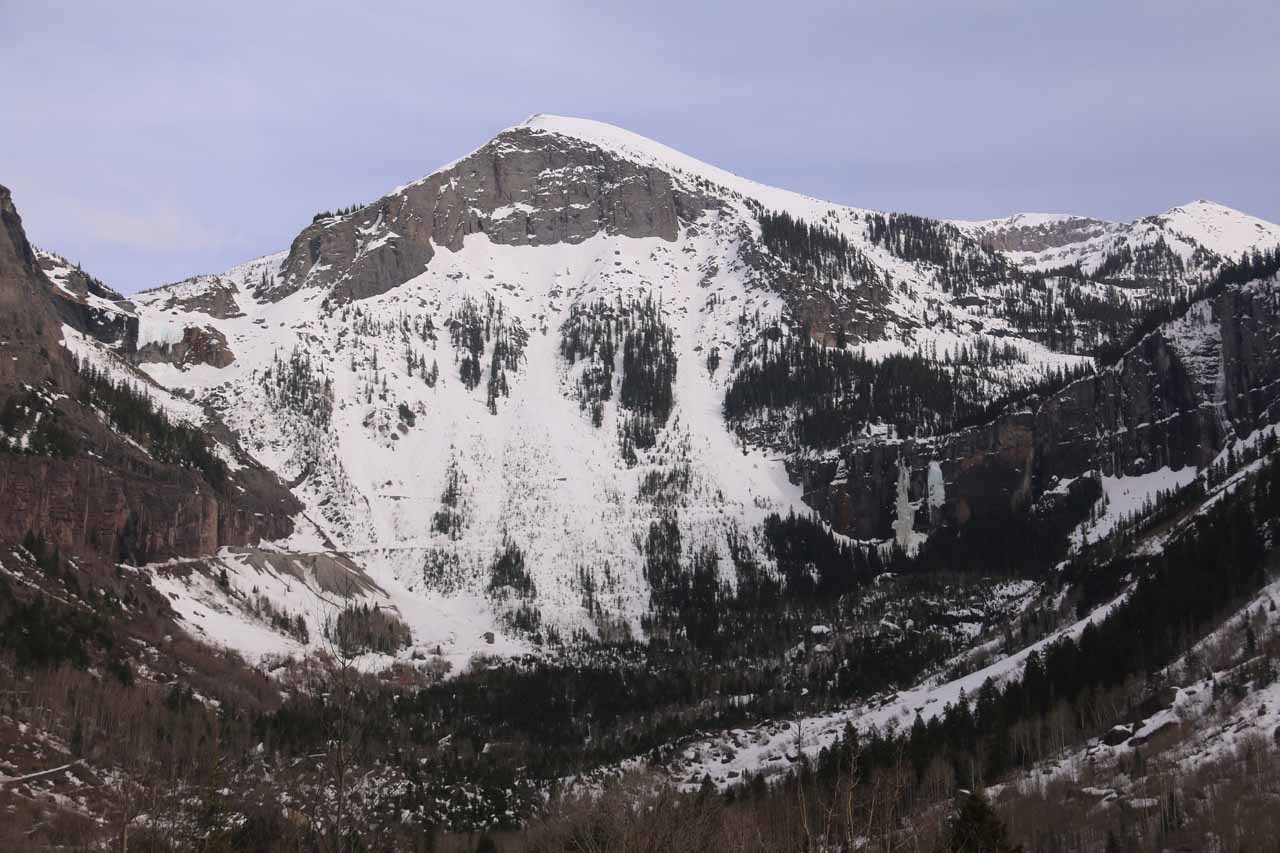 Context of what I think is Trico Peak towering over the frozen Bridal Veil Falls and the snowy switchbacks