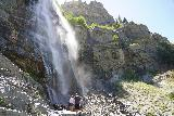 Bridal_Veil_Falls_Provo_035_08102020 - A couple scrambling a little further to the base of the tallest drop of Bridal Veil Falls as seen in August 2020