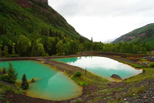 Bridal_Veil_Falls_Telluride_008_07222020 - Looking back across the Idarado Mining Company's settling ponds at the trailhead parking for the Bridal Veil Creek Trail