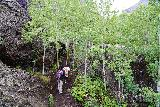 Bridal_Veil_Falls_Telluride_045_07222020 - Context of Tahia and Julie hiking amongst some interesting volcanic rocks hinting at the geology responsible for Bridal Veil Falls