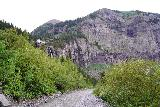 Bridal_Veil_Falls_Telluride_330_07222020 - Looking back along the 4wd road at the context of Bridal Veil Falls, the power station at its brink, and the cliffs around it