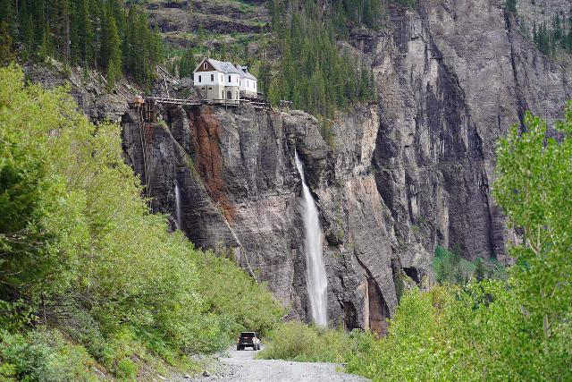 Bridal_Veil_Falls_Telluride_397_07222020 - Context of a 4wd vehicle on the road bryond the base of Bridal Veil Falls