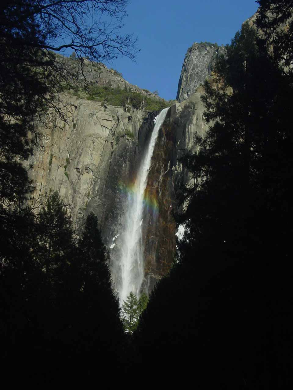 Bridalveil Fall with rainbow going across it from the car park nearest its base in February 2006