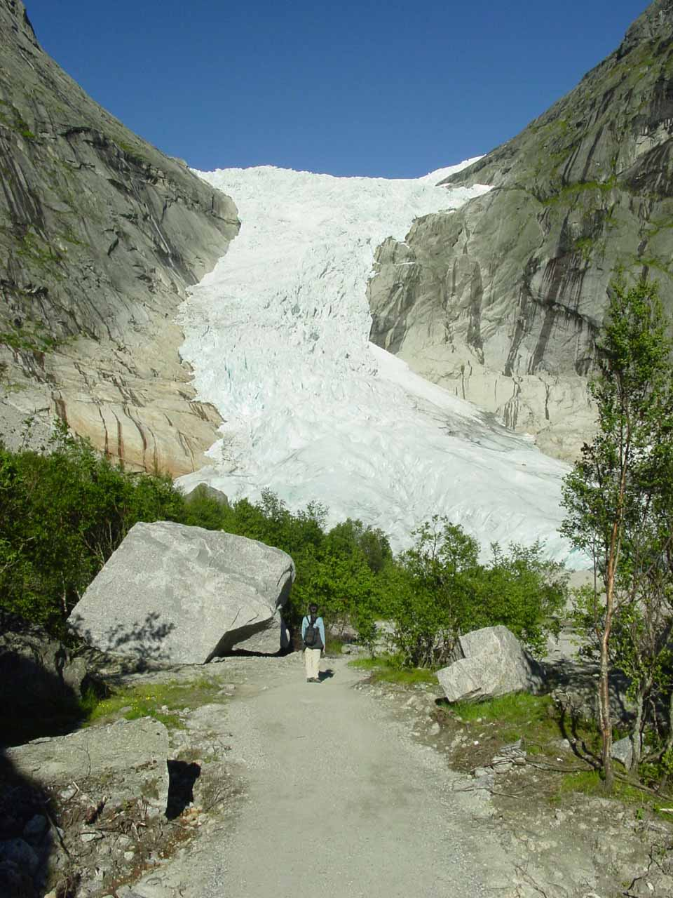 Julie now starting to navigate through boulders before getting up to the terminus of Briksdalsbreen