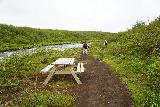 Bruarfoss_083_08062021 - Walking past a picnic table near Hlauptungufoss, which could have made for a nice spot for a picnic if we were inclined to spend more time around this waterfall