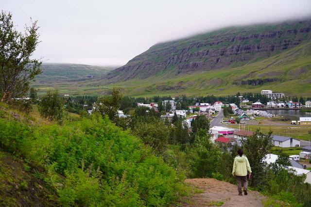 Budararfoss_052_08112021 - Mom heading back towards Seyðisfjörður after leaving the bottom of Buðarárfoss. Notice Gufufoss way in the distance