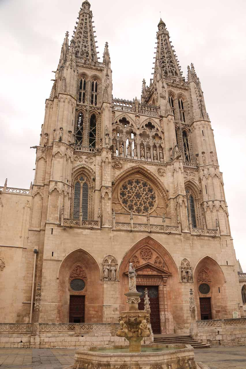 Looking up over a fountain at Plaza de Santa Maria towards one of the side entrances of the Catedral de Burgos