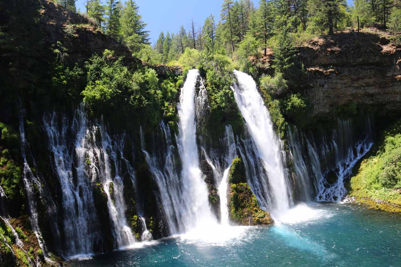 Slightly angled look at Burney Falls and its colorful plunge pool