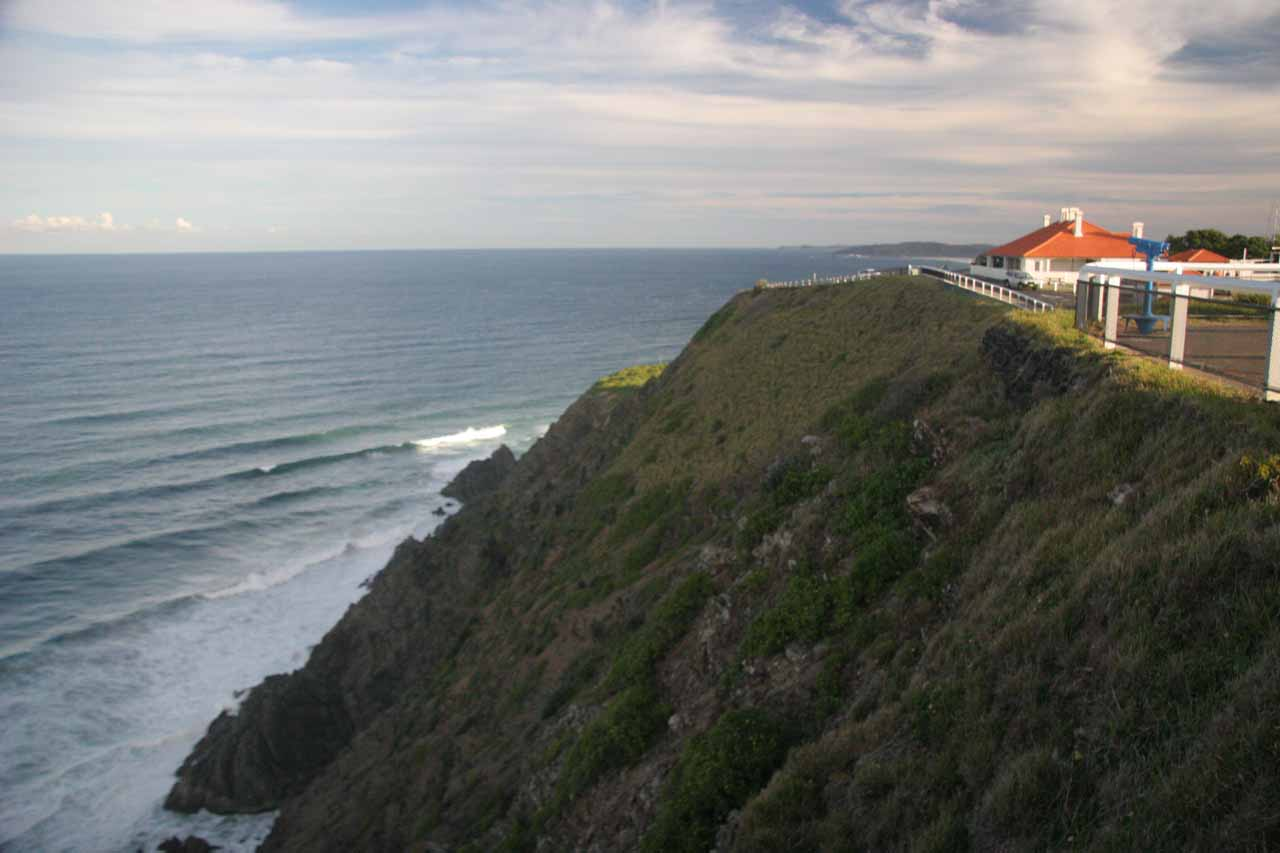 Looking out towards the Pacific past some cliffside buildings near the Byron Bay Lighthouse
