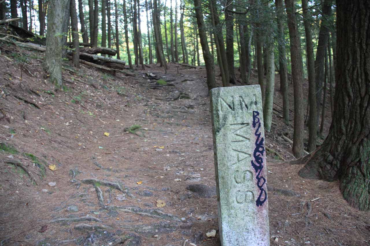 The other side of the state border marker on the Campbell Falls trail